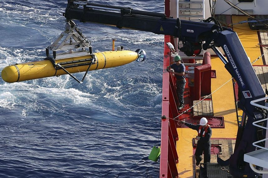 The Bluefin-21 Autonomous Underwater Vehicle is craned over the side of the Australian Defence Vessel Ocean Shield in the southern Indian Ocean during the continuing search for the missing Malaysian Airlines flight MH370 in this picture released by t