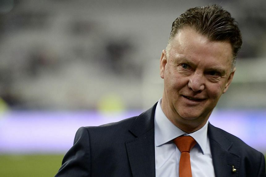 Netherlands' coach Louis van Gaal waits for the start of a friendly football match between France and Netherlands at the Stade de France in Saint-Denis near Paris on March 5, 2014. -- FILE PHOTO: AFP