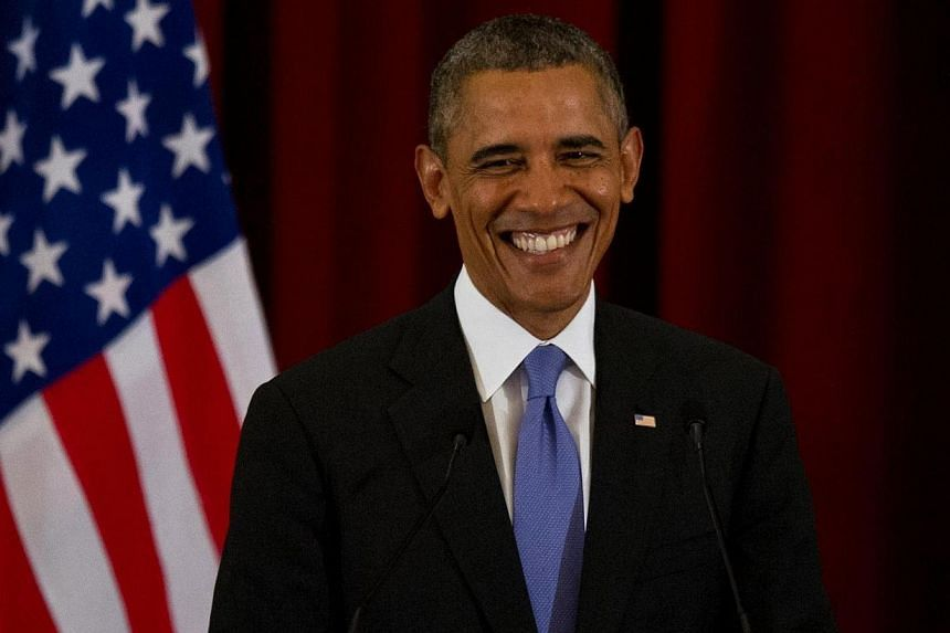 US President Barack Obama smiles as he answers questions during a joint press conference at Seri Perdana in Malaysia's administrative capital of Putrajaya on April 27, 2014.President Barack Obama nudged Malaysia on Sunday, April 27, 2014,