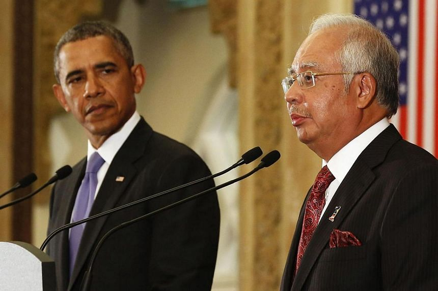 US President Barack Obama listens to Malaysian Prime Minister Najib Razak as they participate in a joint news conference at the Perdana Putra Building in Putrajaya on April 27, 2014.US President Barack Obama said on Sunday, April 27, 2014, that