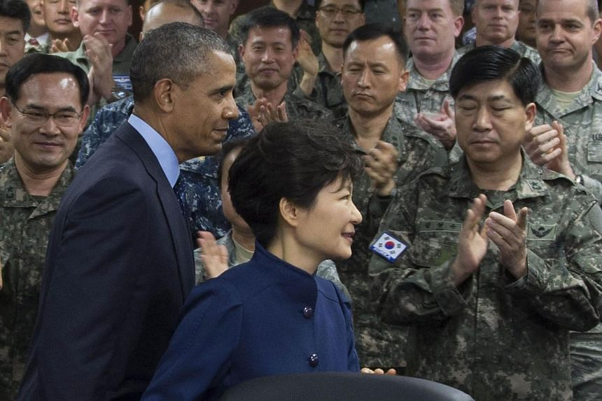 South Korean President Park Geun-Hye (right) and US President Barack Obama (left) arrive to receive a briefing from United Nations Commander General of US-ROK Combined Forces Command in Seoul on April 26, 2014.North Korea launched a vicious per
