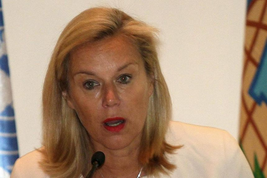 Sigrid Kaag, head of the joint Organisation for the Prohibition of Chemical Weapons (OPCW)-United Nations mission for the destruction of Syria's chemical weapons, talks to reporters in the Syrian capital, Damascus on April 27, 2014.Syria still