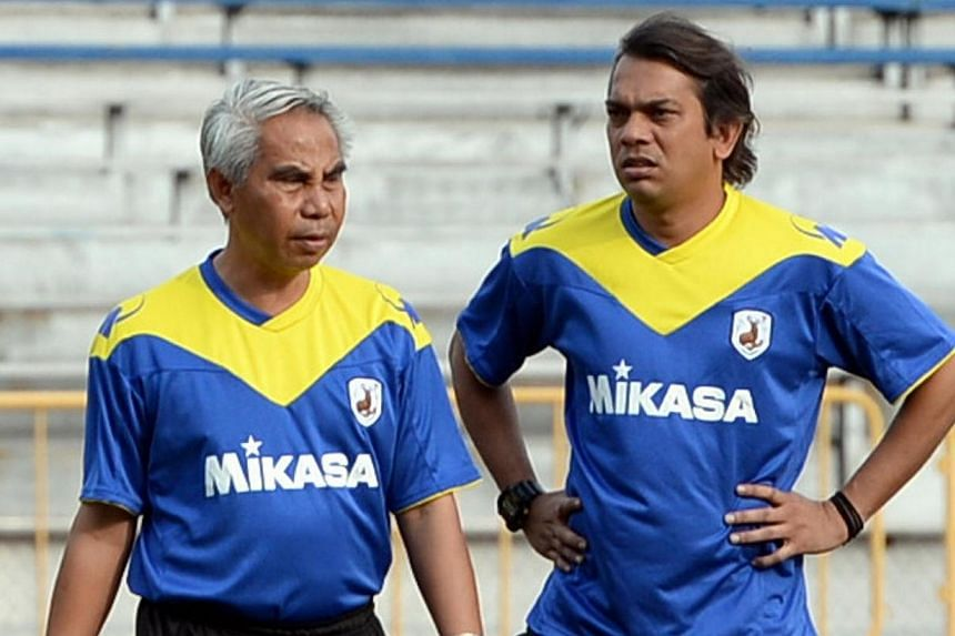 Tampines Rovers' head coach Salim Moin (left) and assistant coach Rafi Ali at a training session at Clementi Stadium on Jan 22, 2014. Salim Moin has resigned as head coach of defending S-League champions on Sunday, April 27, 2014.  -- ST FI