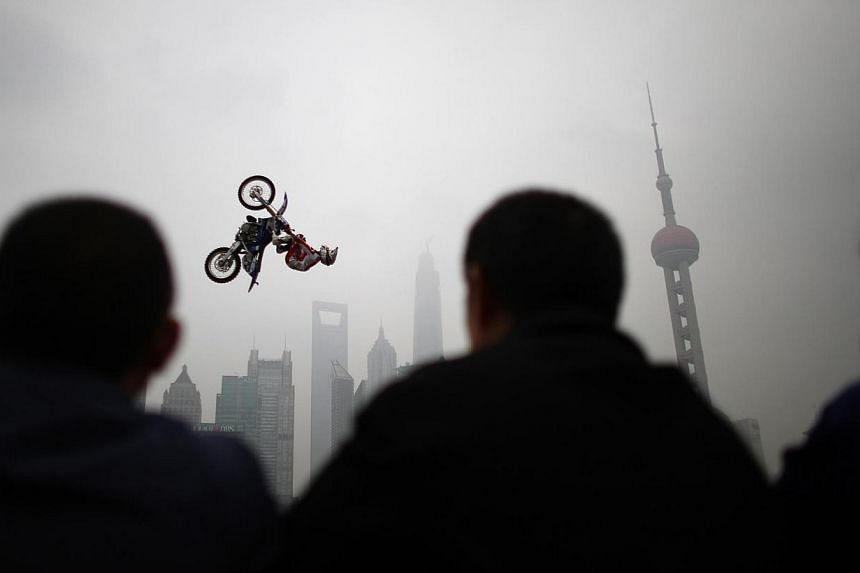 Michael Norris of Australia performs during a presentation of the World Extreme Games in Shanghai on April 27, 2014.The Kia World Extreme Games, which will begin on Wednesday, April 30, 2014, at the Jiangwan Stadium in Shanghai, kicked off on S