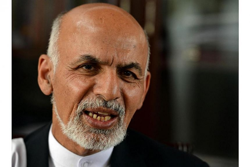 Afghan presidential candidate Ashraf Ghani Ahmadzai speaks during an interview with AFP at his residence in Kabul on April 14, 2014. Afghan presidential candidate Ashraf Ghani pledged on Sunday, April 27, 2014, to fight on after coming second in