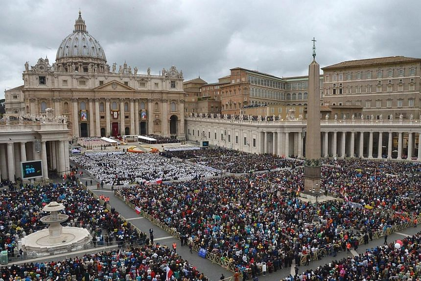 General view of the canonisation mass of Popes John XXIII and John Paul II on St Peter's at the Vatican on April 27, 2014. -- PHOTO: AFP
