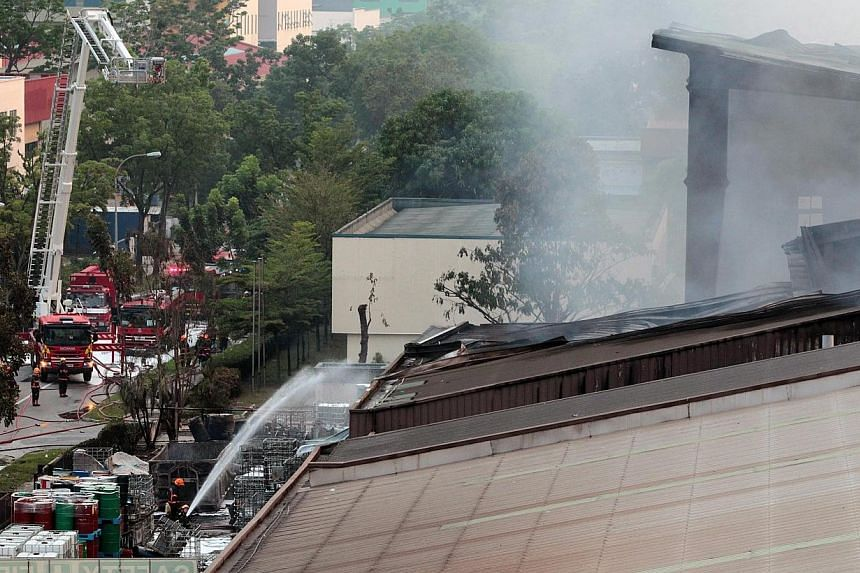 A fire broke out at a warehouse on Tuas Avenue 11 in Singapore on Sunday, April 27, 2014, afternoon, involving waste products, and affecting an area of 40m by 40m. -- ST PHOTO: NEO XIAOBIN