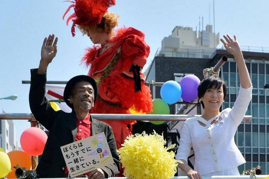 """Akie Abe (white dress), wife of Japanese Prime Minister Shinzo Abe, takes part in the """"Tokyo Rainbow Pride"""" parade for the anti AIDS campaign in Tokyo on April 27, 2014.Japan's first lady Akie Abe joined the annual gay parade in Tokyo on Sunday"""
