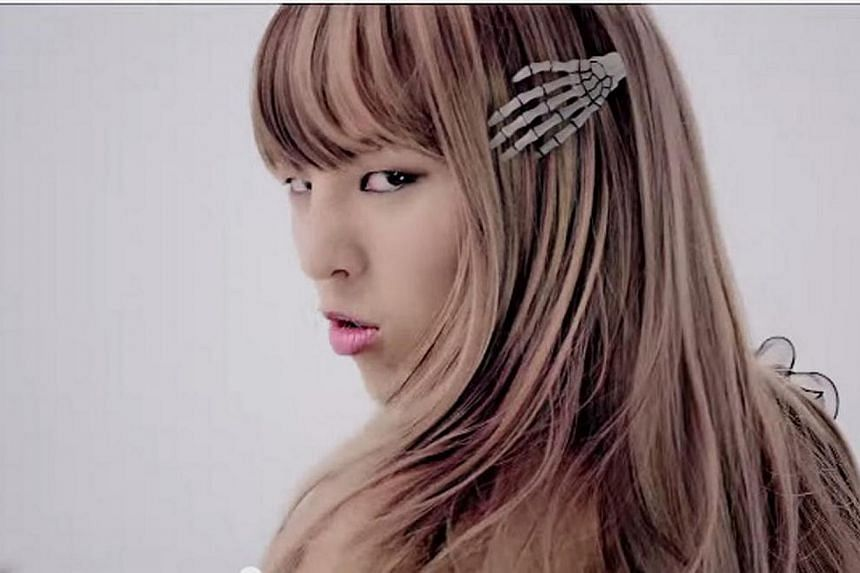 G-Dragon turned up in drag in his music video Crayon, complete with flowing blonde tresses. -- BIGBANG YOUTUBE CHANNEL