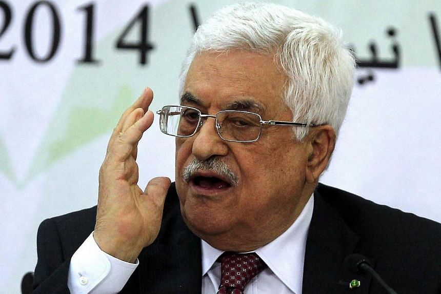 Palestinian Authority President Mahmud Abbas gestures as he gives a speech during a meeting with the Palestine Liberation Organisation (PLO)'s Central Council in the West Bank city of Ramallah on April 26, 2014. The mass killing of Jews in the H
