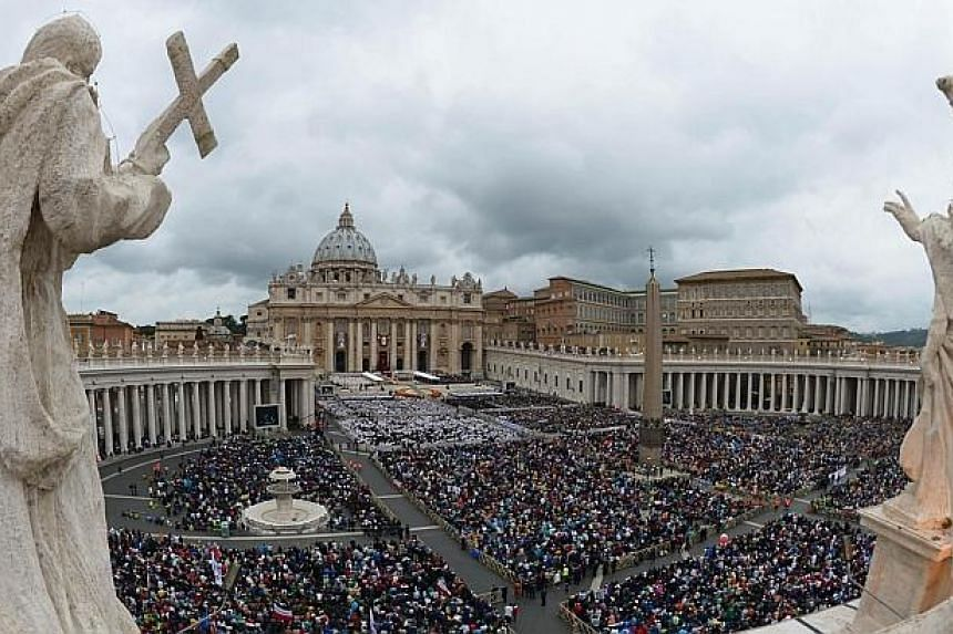 A view of the crowd that gathered for the canonisation mass of Popes John XXIII and John Paul II on St Peter's square at the Vatican on April 27, 2014. -- PHOTO: AFP
