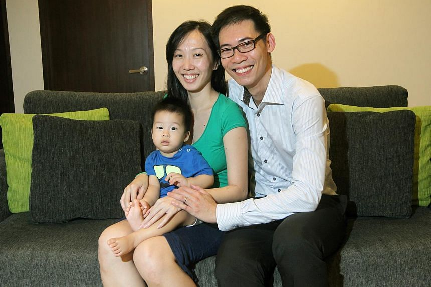 """Mr Ng Yau Wei, 42, with his wife Yap Jun Ting, 28, and their one-year-old son Ethan Ng Sheng Zhe. Before he married, Mr Ng used to dabble in penny stocks and bought shares based on """"slipshod homework"""". Now that he has a family, he sticks to blue-"""