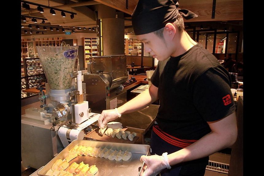 The gyozas are made fresh at the 70-seat casual restaurant using a machine from Japan. -- ST PHOTO: LAU FOOK KONG