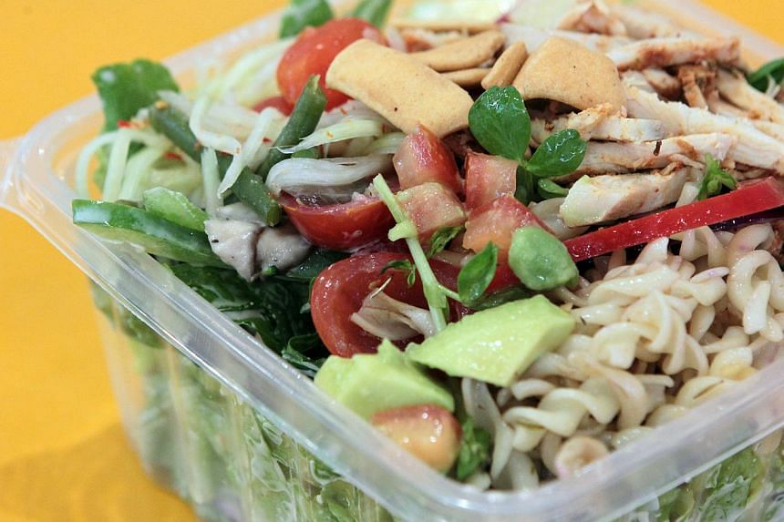Salad with wafu dressing topped with paprika herb chicken, papaya salad, yogurt apple, pasta, cherry tomatoes and other basic toppings. -- ST PHOTO: NEO XIAOBIN