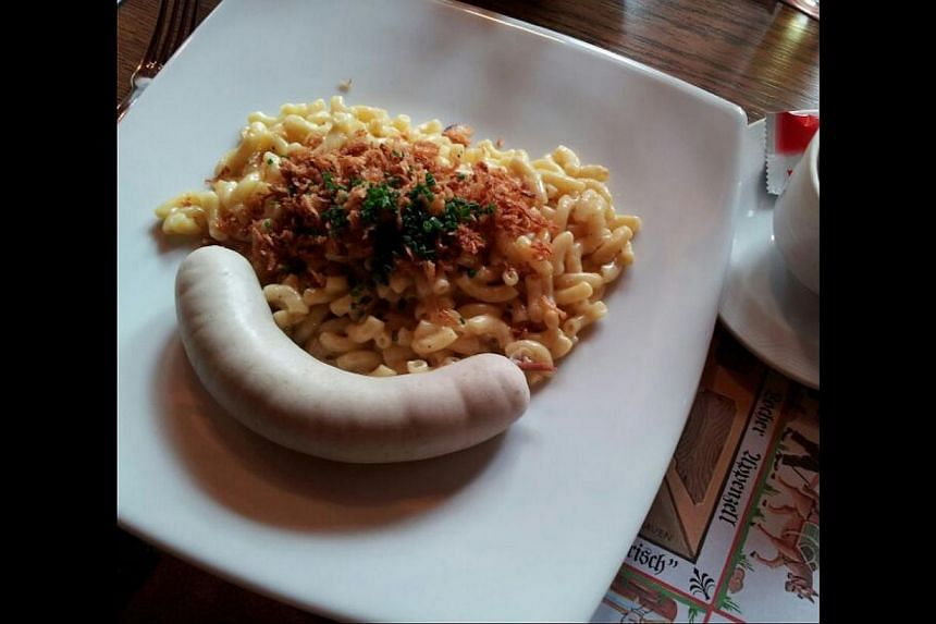 The dish kasehornli, a local version of macaroni and cheese served with apple sauce and Swiss white beef sausage, is popular. -- PHOTO: YIP WAI YEE