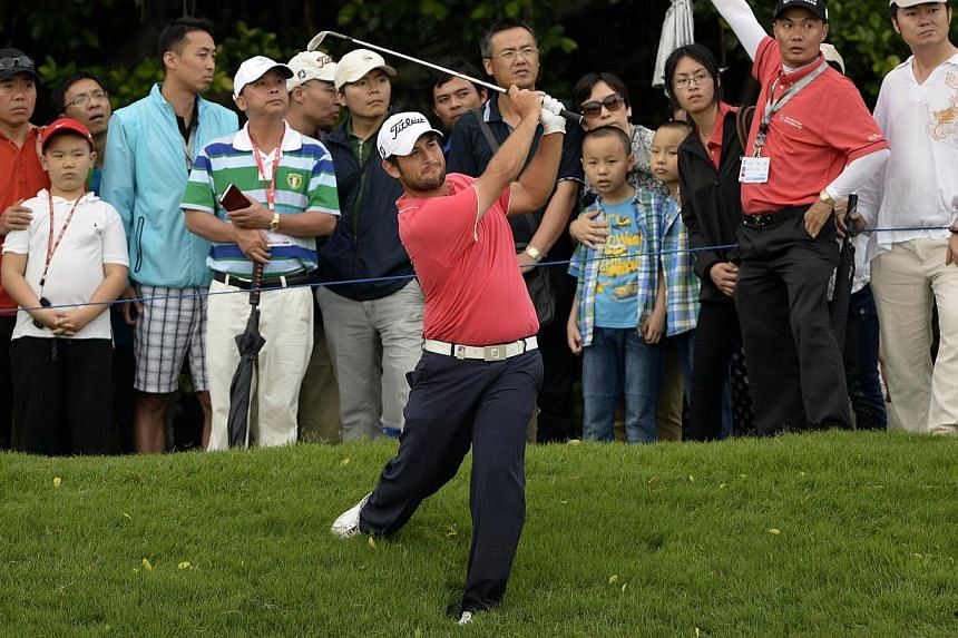 This handout photo taken and received by OneAsia on April 26, 2014 shows Alexander Levy of France as he hits a shot during the third round of the Volvo China Open at the Genzon Golf Club in the southern Chinese city of Shenzhen. -- PHOTO: AFP