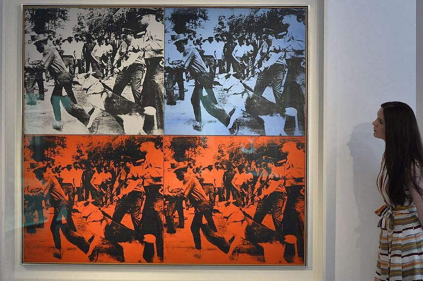 Andy Warhol was one of the most influential American artists of the 20th century and his work continues to sell for record prices. This artwork by him, Race Riot, was photographed at Christie's auction house in central London, on April 11, 2014. -- P