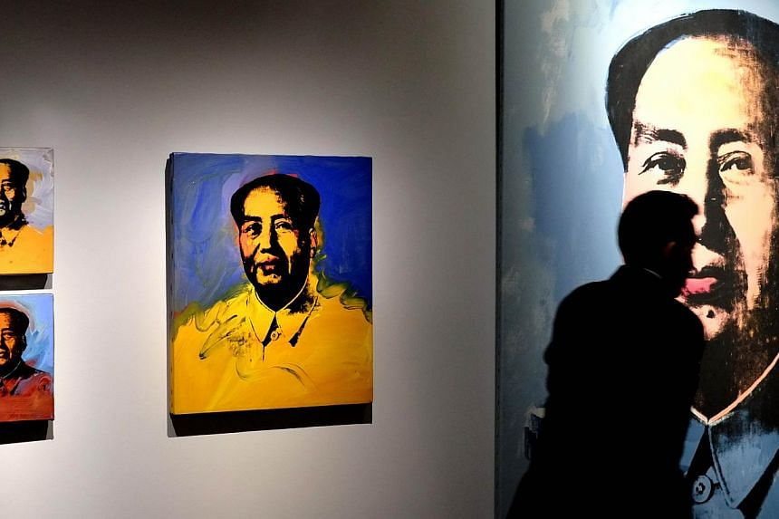 Andy Warhol was one of the most influential American artists of the 20th century. His Mao series was part of the exhibition Warhol exhibited in Rome on April 17, 2014. -- PHOTO: AFP