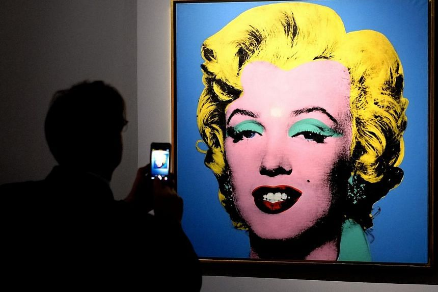 Andy Warhol was one of the most influential American artists of the 20th century. Blue Shot Marilyn was part of the exhibition Warhol in Rome on April 17, 2014. -- PHOTO: AFP