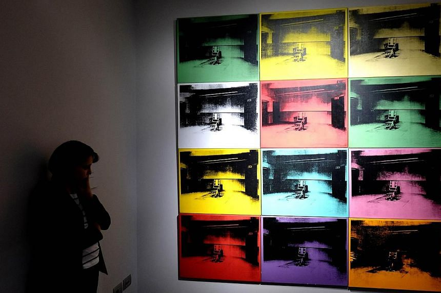 Warhol was one of the most influential American artists of the 20th century. This work, Electric Chairs, was part of the exhibition Warhol in Rome on April 17, 2014. -- PHOTO: AFP