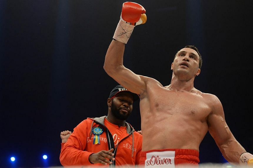 Ukrainian World heavyweight boxing champion Wladimir Klitschko celebrates victory over Australia's Alex Leapai after the WBA, IBF, WBO and IBO title bout in Oberhausen, north-western Germany, on April 26, 2014. - PHOTO: AFP