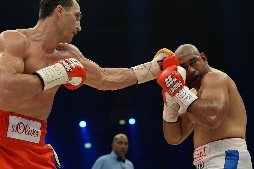 Ukrainian World heavyweight boxing champion Wladimir Klitschko (left) and Australia's Alex Leapai fight during the WBA, IBF, WBO and IBO title bout in Oberhausen, north-western Germany, on April 26, 2014. -- PHOTO: AFP