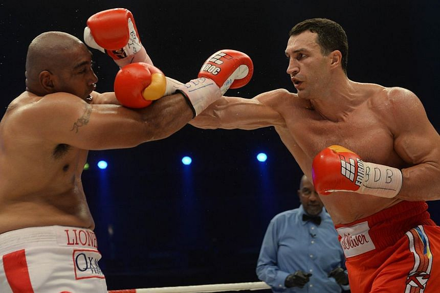 Ukrainian World heavyweight boxing champion Wladimir Klitschko (right) and Australia's Alex Leapai fight during the WBA, IBF, WBO and IBO title bout in Oberhausen, north-western Germany, on April 26, 2014. -- PHOTO: AFP