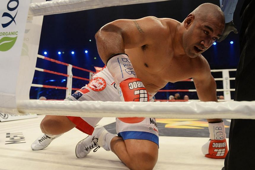 Australia's Alex Leapai is knocked out by Ukrainian World heavyweight boxing champion Wladimir Klitschko during the WBA, IBF, WBO and IBO title bout in Oberhausen, north-western Germany, on April 26, 2014. -- PHOTO: AFP