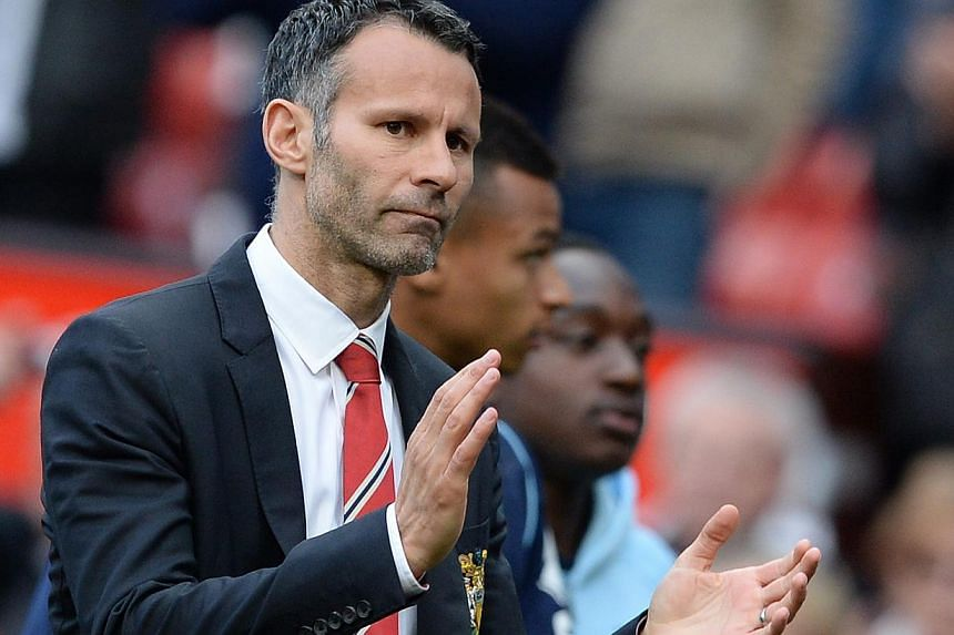 Manchester United's manager Ryan Giggs reacts after their English Premier League football match against Norwich City at Old Trafford in Manchester, northern England, April 26, 2014. -- PHOTO: REUTERS