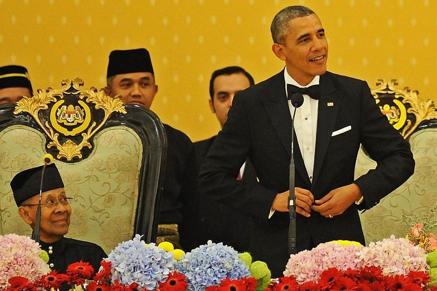 US President Barack Obama presenting a speech while Malaysian King Sultan Abdul Halim Mu'adzam Shah looks on during a state banquet at the National Palace in Kuala Lumpur, Malaysia, on April 26, 2014. Mr Obama is the first US President to visit Malay