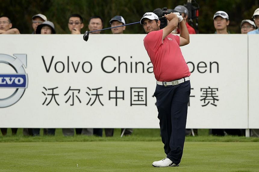 This handout photo taken and received by OneAsia on April 26, 2014 shows Alexander Levy of France hits a shot during the third round of the Volvo China Open at the Genzon Golf Club in the southern Chinese city of Shenzhen. -- PHOTO: AFP