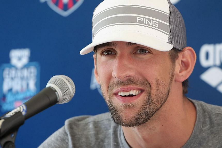 Michael Phelps at a press conference after competing in the Men's 50m Freestyle prelim during day two of the Arena Grand Prix at the Skyline Aquatic Centre on April 25, 2014 in Mesa, Arizona. -- FILE PHOTO: AFP
