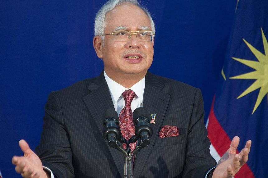 Malaysia's Prime Minister Najib Razak gestures as he speaks during a tour of the Malaysian Global Innovation & Creativity Centre in Cyberjaya, outside Kuala Lumpur on April 27, 2014. -- PHOTO: AFP