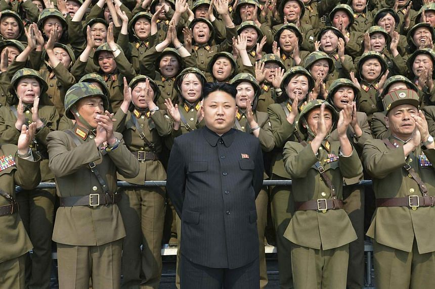 North Korean leader Kim Jong Un receives applause as he guides the multiple-rocket launching drill of women's sub-units under KPA Unit 851, in this undated photo released by North Korea's Korean Central News Agency on April 24, 2014. -- FILE PHOTO: R