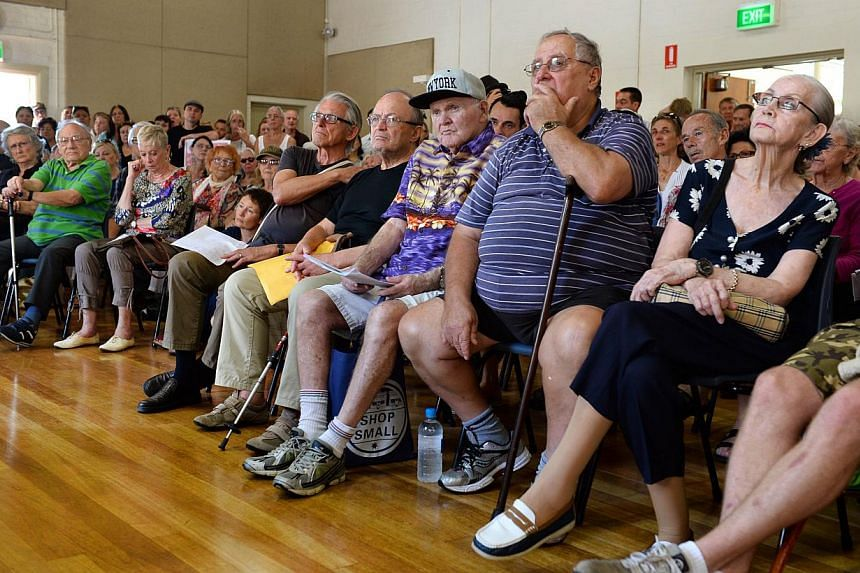 This photo taken on March 22, 2014, shows Ron Jennings (centre), 84, listening to speeches during a meeting of residents who face being removed from their public housing at Sydney's Millers Point. -- FILE PHOTO: AFP