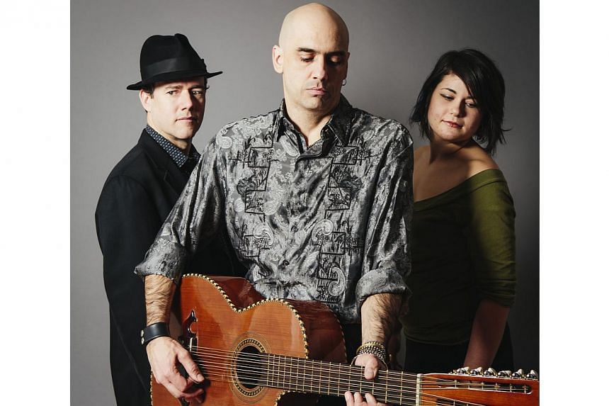 American musicologist Tim Eriksen (centre) extols the virtues of shape-note music. -- PHOTO: TIM ERIKSEN & BAND