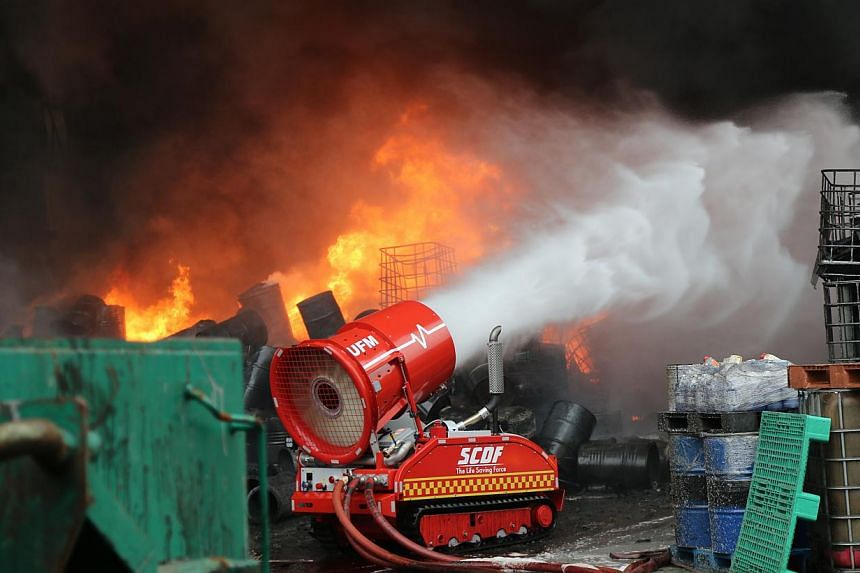 A fire broke out at a warehouse on Tuas Avenue 11 in Singapore on Sunday, April 27, 2014, afternoon, involving waste products, and affecting an area of 40m by 40m. -- PHOTO: SINGAPORE CIVIL DEFENCE FORCE
