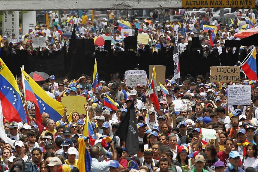 Anti-government protesters march against education reforms in Caracas on April 26, 2014. -- PHOTO: REUTERS
