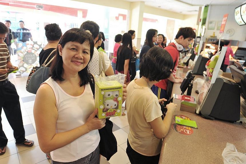 Madam Kim Yeo, a homemaker, was one of the first few patrons to buy the Kerokerokeroppi Hello Kitty plush toy at aMacDonald's outlet at Blk 267 Serangoon Ave 3 on Apr 28 2014.The disappearance of queues, however, is not a sign that the He