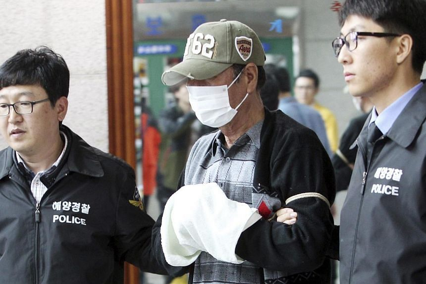 Lee Joon-Seok (Center), captain of South Korean ferry Sewol which sank at sea off Jindo, is seen as he is sent to a prosecutor's office in Mokpo on April 27, 2014. South Korea's coastguard on Monday released a video showing the captain of a sink