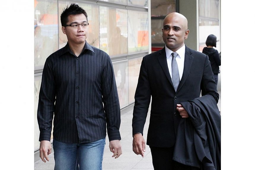 Mr Yong Yun Leong (left), the brother of Yong Vui Kong, and lawyer M. Ravi at the Supreme Court on 14 November 2013.Malaysian drug courier Yong Vui Kong, who was spared the gallows after a string of unsuccessful fights against his death sentenc