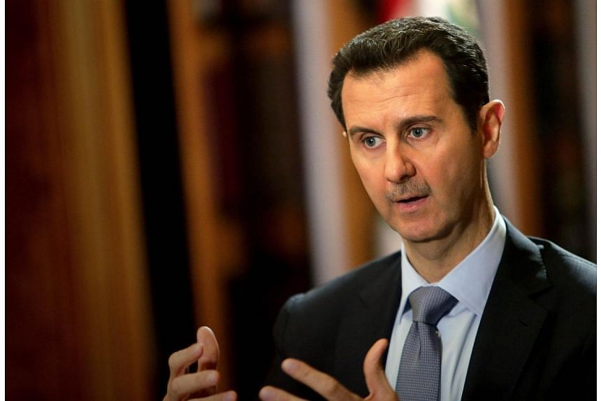 Syrian President Bashar al-Assad during an interview with AFP at the presidential palace in Damascus on Jan 20, 2014.Syria's President Bashar al-Assad has registered to stand in next month's presidential election, which he is widely expected to