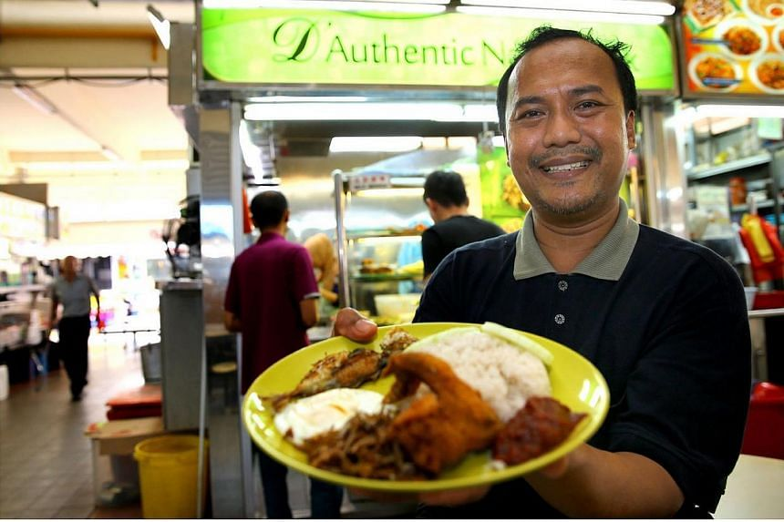 Mr Sulaiman Abu, owner of D'Authentic Nasi Lemak stall at Block 84, Marine Parade Central. He is one of the Hawker Master Trainers in the Hawker Master Trainer Pilot Programme, launched to preserve Singapore's hawker heritage. Thirteen peopl