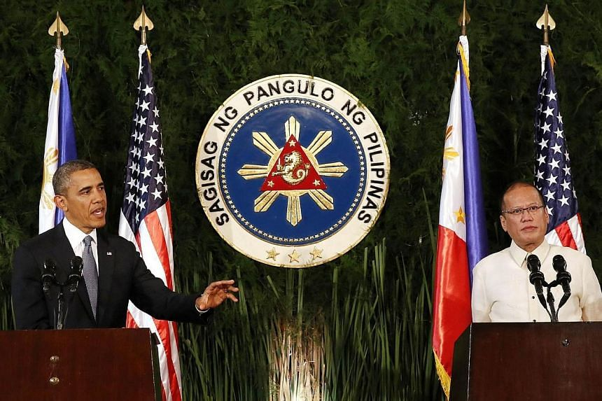 US President Barack Obama talks during a joint news conference with President Benigno Aquino of the Philippines at the Malacanang Palace in Manila on April 28, 2014.The United States is not trying to counter or contain China, Mr Obama said on M