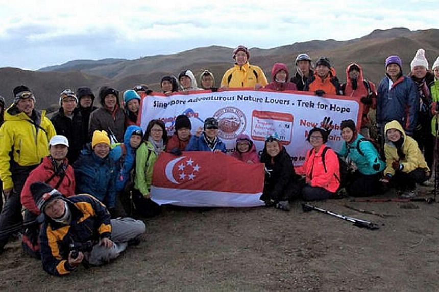 The Trek For Hope, Philippines 2014 team at the summit of Mount Pulag in the Philippines. --PHOTO: SIMON CHAN
