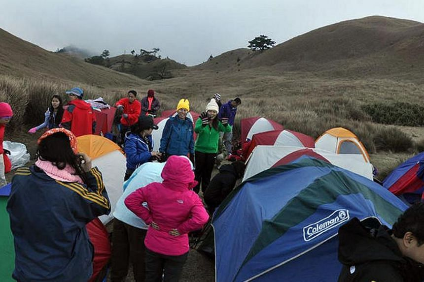 The Trek For Hope team setting up camp at the peak of Mount Pulag in the Philippines.--PHOTO: SIMON CHAN