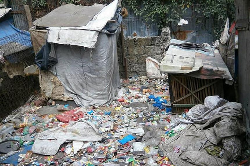 Trash covered the ground in the slums of New Smokey Mountain, which used to be a landfill. -- PHOTO: SIMON CHAN