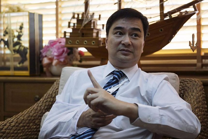 Thailand's opposition leader and former Prime Minister Abhisit Vejjajiva gestures during an interview with foreign media at his Democrat Party headquarters in Bangkok on April 23, 2014.Thai opposition leader Abhisit Vejjajiva met the head of th