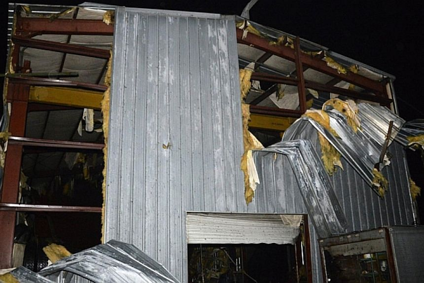 Debris is seen at a damaged business after a tornado hit the town of Mayflower, Arkansas around 7:30 pm CST, late on April 27, 2014. -- PHOTO: REUTERS