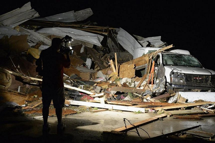 First In Video news video photographer Brad Mack covers the damage seen after a tornado hit the town of Mayflower, Arkansas around 7:30 pm CST, late on April 27, 2014. -- PHOTO: REUTERS